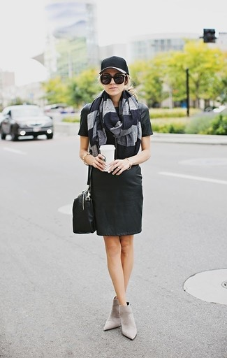 How to wear: black leather shift dress, grey suede ankle boots, black leather crossbody bag, black cap