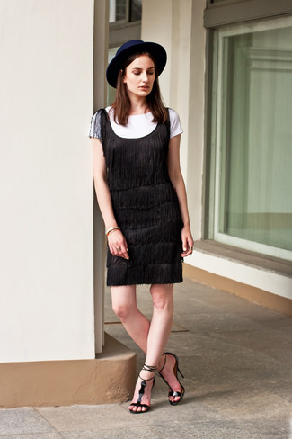 How to Wear a Navy Wool Hat For Women: Chic yet practical, this ensemble combines a black fringe shift dress and a navy wool hat. Introduce black leather heeled sandals to this look for an added touch of style.