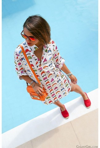 Go for a white print shift dress if you're going for a neat, stylish look. Red canvas espadrilles will contrast beautifully against the rest of the look.