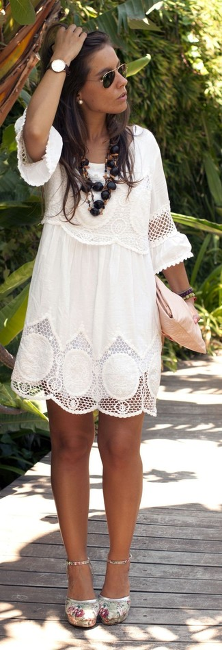 Perfect the smart casual look in a white lace shift dress. Finish off your look with beige floral canvas pumps.
