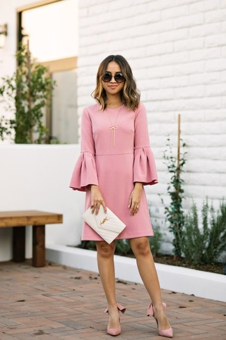 Master the effortlessly chic look in a pink ruffle shift dress and black sunglasses. Pink suede pumps complement this look quite nicely. As you can guess, this is also a kick-ass choice when spring comes.