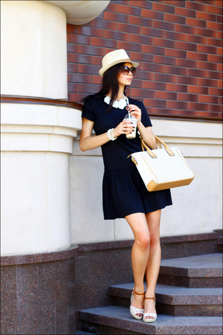 Dress in a navy shift dress to feel confidently and look fashionably. Want to go easy on the shoe front? Go for a pair of white crochet wedge sandals for the day.