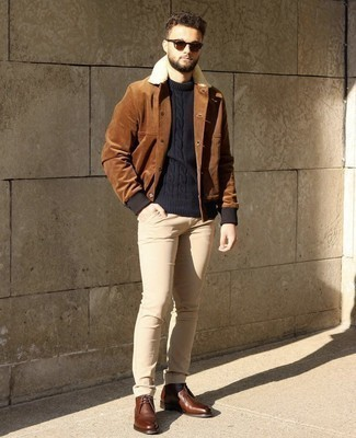 Cable Sweater Outfits For Men: A cable sweater and beige jeans are absolute menswear staples that will integrate wonderfully within your day-to-day wardrobe. Complement your ensemble with brown leather desert boots and the whole ensemble will come together.