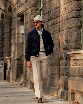 How to wear: navy shirt jacket, beige cable sweater, light blue vertical striped long sleeve shirt, beige chinos