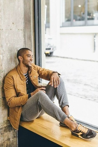 Black Cardigan Outfits For Men In Their 20s: Marrying a black cardigan with grey wool chinos is a good pick for an off-duty look. Why not take a more laid-back approach with shoes and add a pair of dark brown athletic shoes to your ensemble? Perfect if you're searching for some amazingly inspiring off-duty style for 20-something gentlemen.