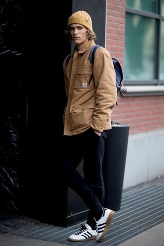 How to Wear a Tan Beanie For Men: One of the coolest ways for a man to style out a tan shirt jacket is to team it with a tan beanie for a casual outfit. To add some extra definition to this look, complete this look with white and black leather low top sneakers.
