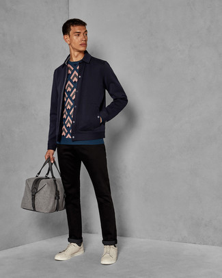 How to wear: navy wool shirt jacket, teal print crew-neck sweater, black chinos, beige leather low top sneakers