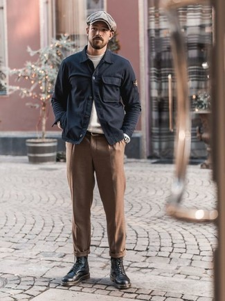 How to Wear a Dark Brown Leather Belt For Men: If it's ease and practicality that you're seeking in an outfit, pair a navy shirt jacket with a dark brown leather belt. Bump up this ensemble by finishing off with a pair of black leather casual boots.