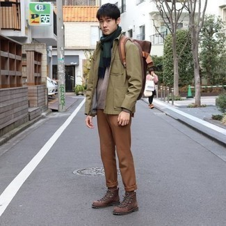Brown Crew-neck Sweater Outfits For Men: The pairing of a brown crew-neck sweater and khaki chinos makes this a neat off-duty look. Take a more relaxed approach with shoes and complete this look with brown leather work boots.
