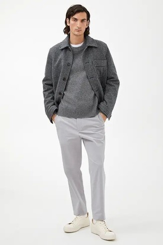 Grey Chinos with Shoes Outfits: Exhibit your skills in men's fashion by wearing this relaxed pairing of a grey check wool shirt jacket and grey chinos. Want to play it down in the shoe department? Introduce white canvas low top sneakers to this ensemble for the day.