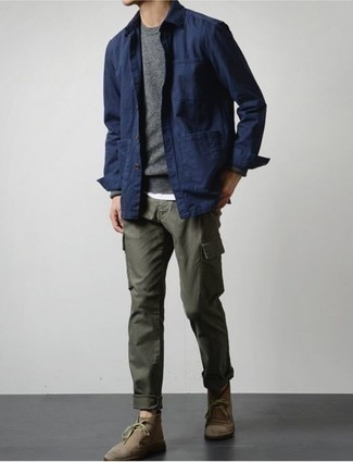 Brown Suede Desert Boots Outfits: For an off-duty outfit with a clear fashion twist, opt for a navy shirt jacket and olive cargo pants. If in doubt about what to wear in the footwear department, stick to a pair of brown suede desert boots.