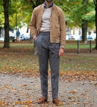 Beige Crew-neck Sweater Outfits For Men: This combo of a beige crew-neck sweater and charcoal dress pants is a surefire option when you need to look really refined. Brown suede tassel loafers are the glue that brings your getup together.
