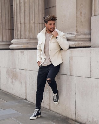 Beige Crew-neck Sweater Spring Outfits For Men: A beige crew-neck sweater and black ripped jeans are a great pairing to have in your casual arsenal. All you need now is a great pair of black and white canvas high top sneakers. And if you're searching for an amazing transition outfit, this one fits the bill.