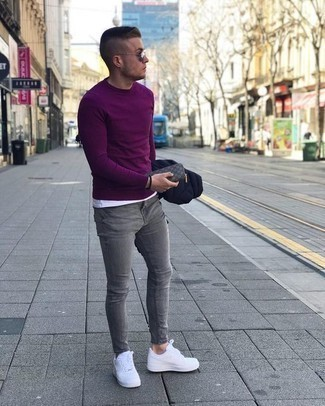 How to Wear Grey Skinny Jeans For Men: A navy quilted shirt jacket and grey skinny jeans are the kind of a winning casual combination that you need when you have zero time to dress up. This getup is completed wonderfully with white leather low top sneakers.