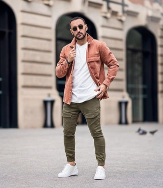 How to wear: pink shirt jacket, white crew-neck t-shirt, olive cargo pants, white leather low top sneakers
