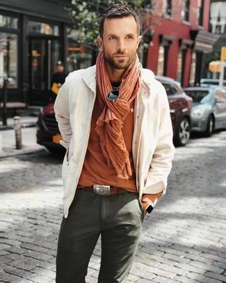 How to wear: beige shirt jacket, orange crew-neck t-shirt, olive chinos, orange scarf