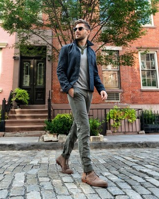 How to wear: navy shirt jacket, grey crew-neck t-shirt, grey chinos, brown suede casual boots