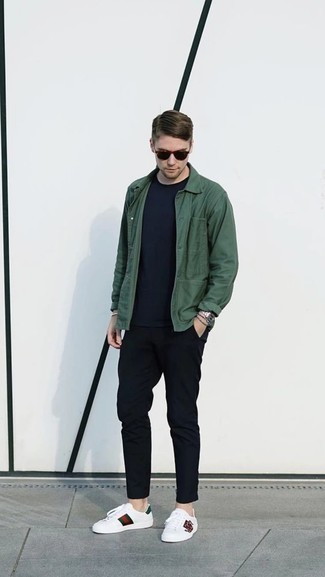 How to Wear White Print Leather Low Top Sneakers For Men: For a look that's effortlessly sleek and wow-worthy, pair a dark green shirt jacket with black chinos. Go the extra mile and spice up your getup by wearing a pair of white print leather low top sneakers.