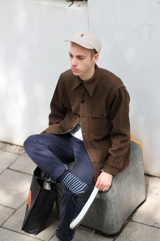 Teen Boy Fashion: What To Wear: Combining a brown wool shirt jacket and navy chinos is a surefire way to inject style into your wardrobe. On the fence about how to finish? Add a pair of black and white canvas low top sneakers to the equation for a more relaxed twist.