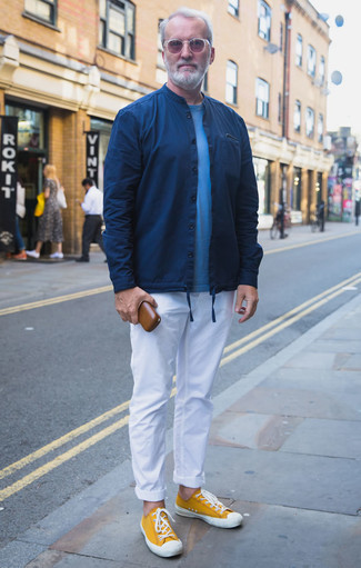 How to Wear Mustard Canvas Low Top Sneakers For Men: This classic and casual pairing of a navy shirt jacket and white chinos is capable of taking on different moods according to how it's styled. Balance out your outfit with a more laid-back kind of footwear, such as this pair of mustard canvas low top sneakers.