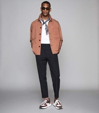 How to Wear Black Chinos: For effortless sophistication with a masculine spin, consider pairing a pink shirt jacket with black chinos. On the fence about how to finish off? Introduce a pair of multi colored athletic shoes to your look to switch things up.