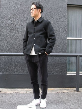 Men's Looks & Outfits: What To Wear In 2020: Consider wearing a black shirt jacket and black chinos if you seek to look seriously stylish without putting in too much effort. Throw in a pair of white canvas high top sneakers to easily up the cool of this ensemble.