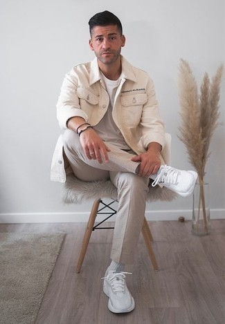 How to Wear a Beige Shirt Jacket For Men: This smart combo of a beige shirt jacket and beige chinos is very easy to throw together without a second thought, helping you look dapper and prepared for anything without spending too much time going through your wardrobe. Rev up the style factor of this getup by wearing a pair of white athletic shoes.