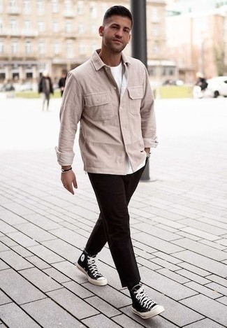 How to Wear a Jacket For Men: Go for a straightforward yet elegant choice marrying a jacket and dark brown chinos. You can get a little creative when it comes to footwear and complete this ensemble with a pair of black and white canvas high top sneakers.