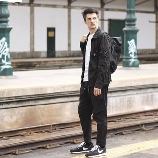 Black Shirt Jacket Outfits For Men: This combination of a black shirt jacket and black chinos is a solid bet when you need to look dapper in a flash. For a more relaxed twist, why not complement this getup with black and white athletic shoes?