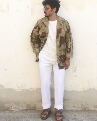 Sandals Outfits For Men: A tan camouflage shirt jacket and white chinos are among those game-changing menswear items that can revolutionize your closet. Wondering how to round off? Introduce a pair of sandals to your ensemble to spice things up.