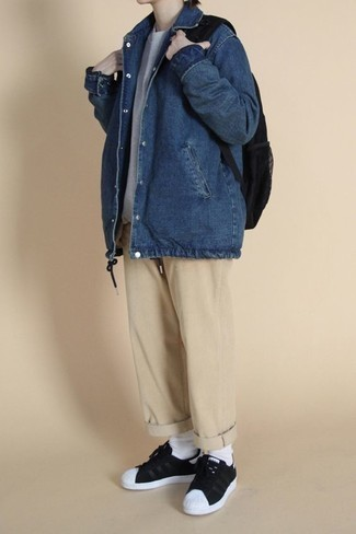 Black Canvas Backpack Outfits For Men: Combining a blue denim shirt jacket with a black canvas backpack is a savvy option for a relaxed ensemble. Black and white canvas low top sneakers will put a dressier spin on an otherwise utilitarian getup.