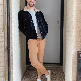 Navy Corduroy Shirt Jacket Outfits For Men: Go for a simple yet dapper getup by marrying a navy corduroy shirt jacket and khaki chinos. For something more on the cool and casual side to complete this outfit, complement this outfit with a pair of white canvas low top sneakers.