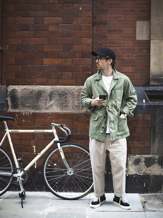 Black Baseball Cap Outfits For Men: For a relaxed casual look, opt for an olive shirt jacket and a black baseball cap — these two pieces play nicely together. For something more on the classy side to finish this ensemble, introduce a pair of black and white canvas low top sneakers to the equation.