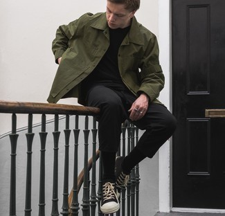 Black and White Canvas Low Top Sneakers Outfits For Men: This semi-casual combo of an olive shirt jacket and black chinos can take on different nuances depending on how it's styled. Add a pair of black and white canvas low top sneakers to the mix to effortlessly boost the wow factor of this ensemble.