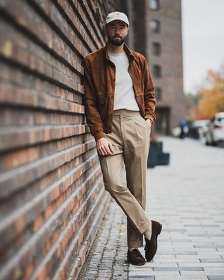 Crew-neck T-shirt Outfits For Men: If you're in search of a laid-back but also sharp look, consider teaming a crew-neck t-shirt with khaki chinos. Let your sartorial savvy really shine by finishing your look with a pair of dark brown suede tassel loafers.