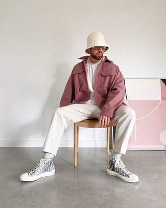 Bucket Hat Outfits For Men: Go for a pared down but at the same time cool and relaxed option by marrying a pink shirt jacket and a bucket hat. A pair of grey print canvas high top sneakers serves as the glue that will bring your ensemble together.
