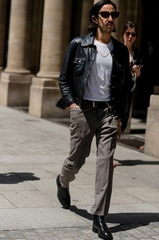 Black Leather Chelsea Boots Outfits For Men: Swing into something casually smart yet timeless in a black leather shirt jacket and grey chinos. Why not introduce black leather chelsea boots to the mix for a dash of elegance?