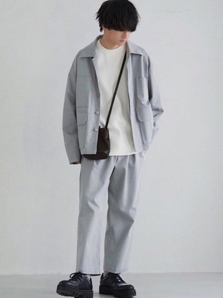 1200+ Outfits For Men In Their Teens: As you can see here, it doesn't take that much time for a man to look casually sleek. Just pair a grey shirt jacket with grey chinos and you'll look incredibly stylish. If you need to immediately dial up this ensemble with footwear, add a pair of black chunky leather derby shoes to your outfit. Those who wonder how to sport classic and casual outfits as you make your way through your teen years, this ensemble should answer your question.