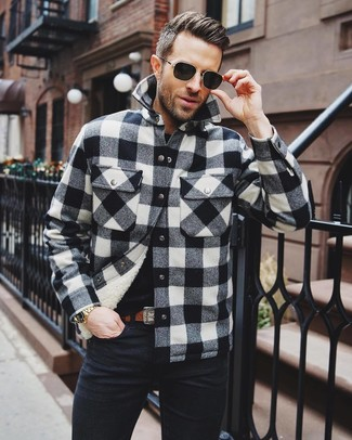 How to wear: black and white check shirt jacket, black crew-neck t-shirt, black jeans, brown leather belt