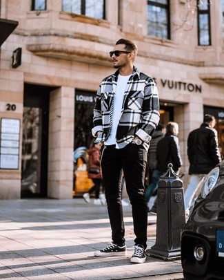 How to wear: white and black plaid flannel shirt jacket, white crew-neck t-shirt, black jeans, black and white canvas low top sneakers