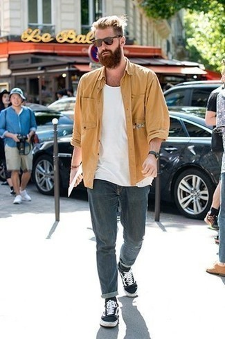 How to Wear Brown Sunglasses For Men: Beyond stylish, this combo of a tan shirt jacket and brown sunglasses provides with variety. Complete this ensemble with black and white canvas low top sneakers to instantly switch up the look.