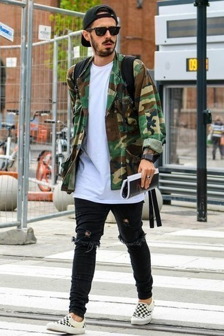 How to Wear Jeans For Men: An olive camouflage shirt jacket and jeans are a contemporary pairing that every stylish man should have in his casual wardrobe. If not sure about the footwear, introduce a pair of black and white check canvas slip-on sneakers to the mix.