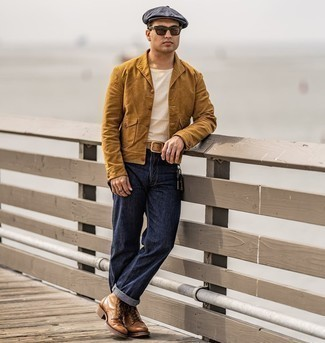 Flat Cap Outfits For Men: A tobacco shirt jacket and a flat cap are the kind of a never-failing casual getup that you need when you have zero time to spare. To add some extra fanciness to your look, complete your look with brown leather casual boots.