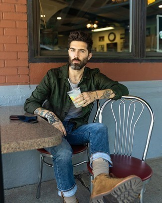 Brown Suede Casual Boots Outfits For Men: This combination of a dark green shirt jacket and navy jeans is a safe and very fashionable bet. Complement this ensemble with a pair of brown suede casual boots and off you go looking boss.