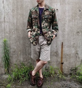 Shorts Outfits For Men: For a winning relaxed option, you can never go wrong with this combo of an olive camouflage shirt jacket and shorts. Add burgundy leather boat shoes to the equation et voila, the look is complete.