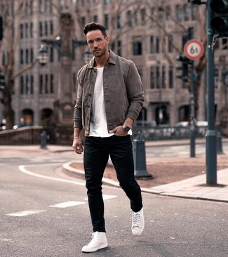 How to wear: charcoal leather shirt jacket, white crew-neck t-shirt, black skinny jeans, white leather high top sneakers
