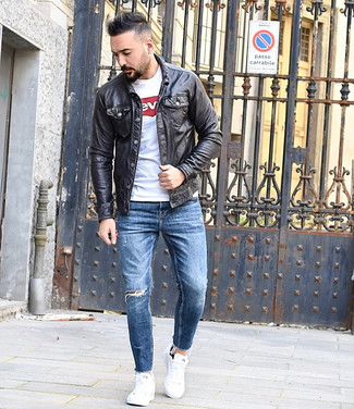 How to wear: black leather shirt jacket, white and red print crew-neck t-shirt, blue ripped skinny jeans, white low top sneakers