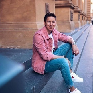Blue Skinny Jeans Outfits For Men: A hot pink corduroy shirt jacket and blue skinny jeans are the perfect way to introduce extra cool into your day-to-day styling rotation. On the footwear front, this look is rounded off really well with white and red canvas low top sneakers.