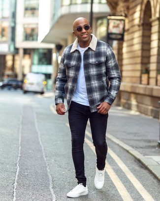 Men's Outfits 2020: For a casually cool ensemble, choose a navy plaid flannel shirt jacket and navy skinny jeans — these pieces play beautifully together. When not sure about what to wear in the footwear department, stick to a pair of white leather low top sneakers.