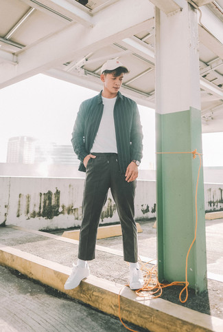 How to wear: black vertical striped shirt jacket, white crew-neck t-shirt, black sweatpants, white canvas low top sneakers